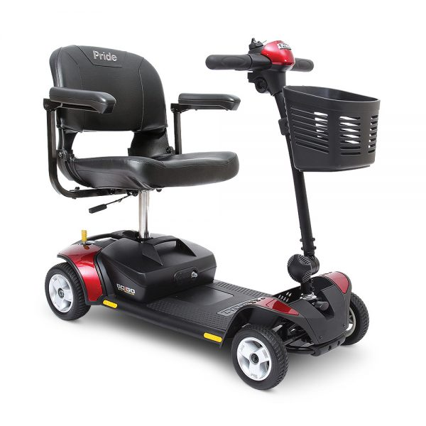 Image of a 4-wheel power scooter. Scooter features chair with arms and front end basket. Color scheme is red and black.